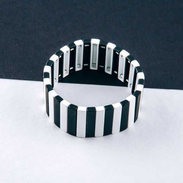 """Lego block stretch bracelet. Approximately 3"""" in diameter unstretched. Fits up to a 6"""" wrist."""