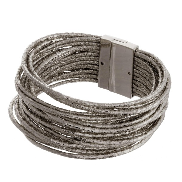 """Faux leather multi-strand metallic bracelet featuring a magnetic closure. Approximately 3"""" in diameter. Fits up to a 6"""" wrist."""