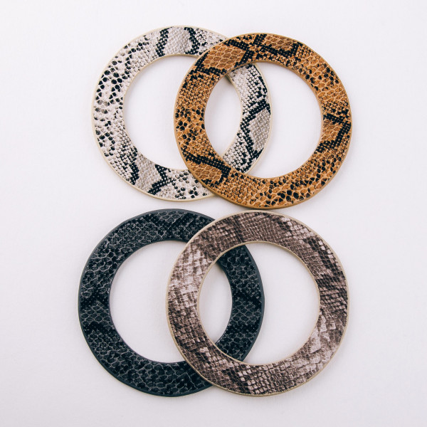 """Soft bendable faux leather snakeskin disc bracelet. Approximately 3"""" in diameter. Fits up to a 6"""" wrist."""