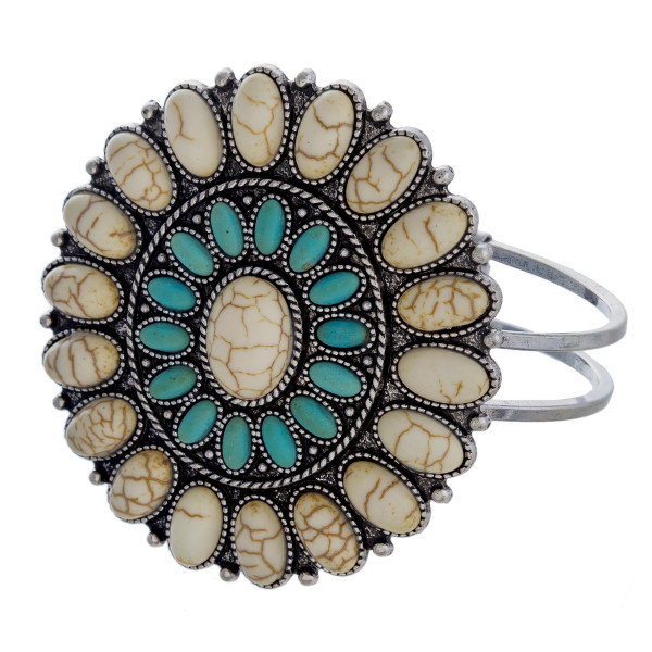 """Hinged bangle bracelet featuring a Western look natural stone focal. Approximately 3"""" in diameter. Fits up to a 6"""" wrist."""