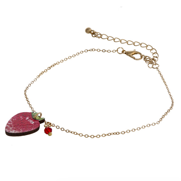 """Dainty cable chain anklet featuring a wood strawberry fruit charm. Approximately 6"""" in diameter."""