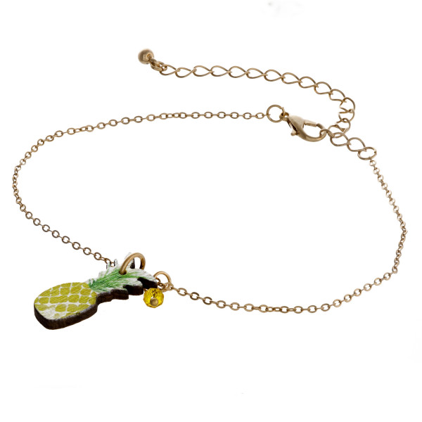 """Dainty cable chain anklet featuring a wood pineapple fruit charm. Approximately 6"""" in diameter."""