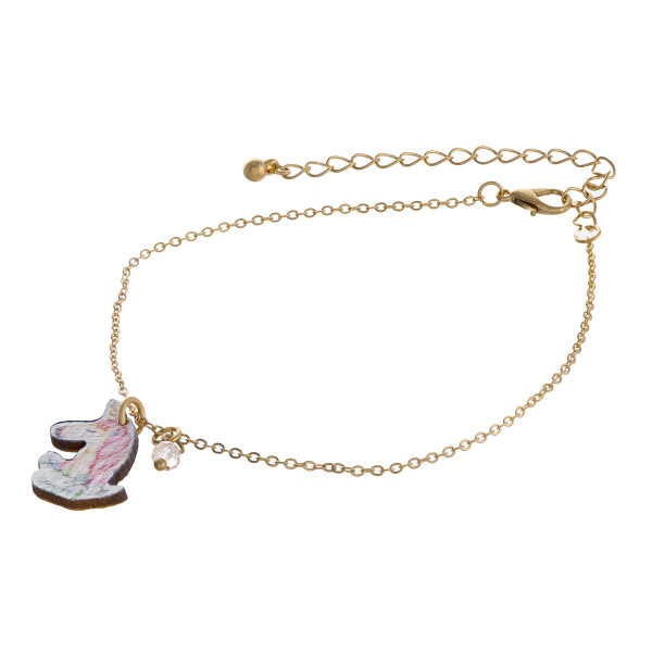 """Dainty cable chain anklet featuring a wood unicorn charm. Approximately 6"""" in diameter."""