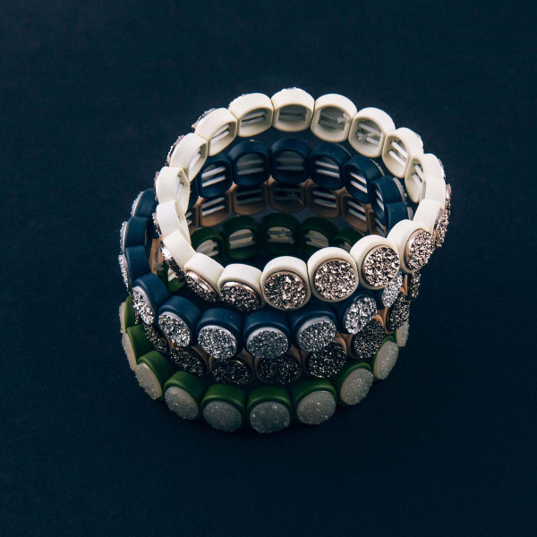 """Druzy encased beaded stretch bracelet. Approximately 3"""" in diameter unstretched. Fits up to a 6"""" wrist."""