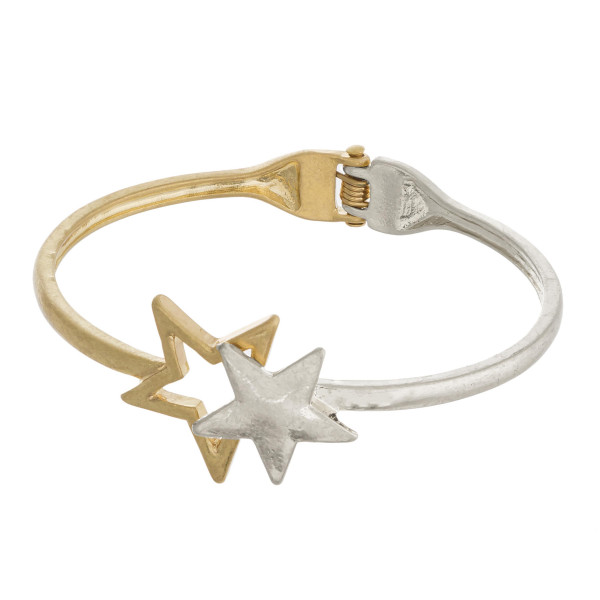 "Two tone hinged bangle bracelet featuring a star focal. Approximately 3"" in diameter. Fits up to a 6"" wrist."