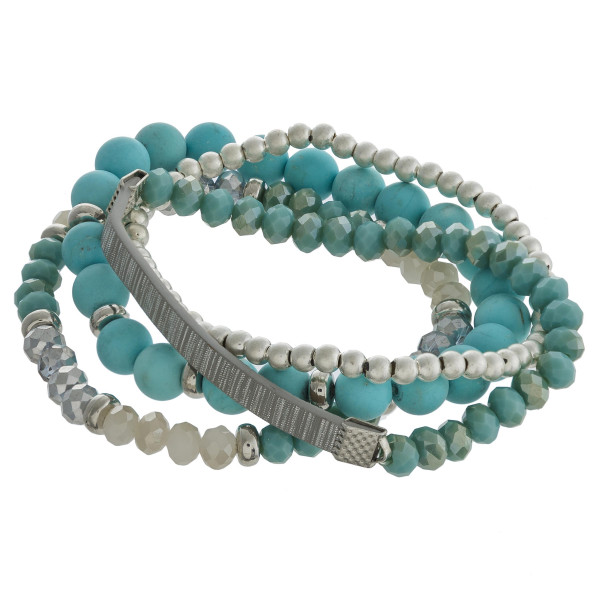 "Multi strand natural stone beaded stretch bracelet set featuring faceted bead and faux leather details. Approximately 3"" in diameter unstretched. Fits up to a 6"" wrist."