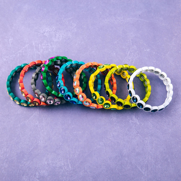 """Iridescent rhinestone stretch bracelet. Approximately 3"""" in diameter unstretched. Fits up to a 6"""" wrist."""