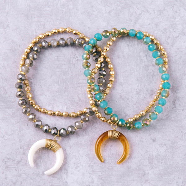 """Beaded stretch bracelet set featuring a crescent charm with wire wrapped details. Approximately 3"""" in diameter unstretched. Fits up to a 6"""" wrist."""