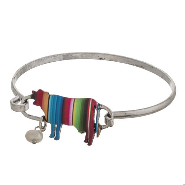 """Enamel coated serape cow bangle bracelet with pearl accent. Approximately 3"""" in diameter. Fits up to a 6"""" wrist."""