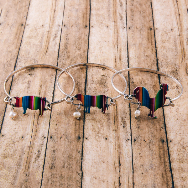 """Enamel coated serape pig bangle bracelet with pearl accent. Approximately 3"""" in diameter. Fits up to a 6"""" wrist."""