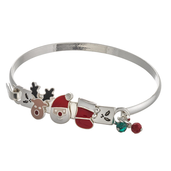 """Enamel coated Christmas character bangle bracelet. Approximately 2.5"""" in diameter. Fits up to a 5"""" wrist."""