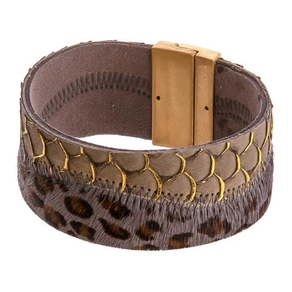 """Faux leather fur animal print magnetic bracelet. Approximately 4"""" in diameter, 1"""" in width. Fits up to a 8"""" wrist."""