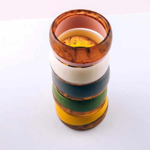 """Matte resin color block stripe bangle bracelet. Approximately 3"""" in diameter. Fits up to a 6"""" wrist."""