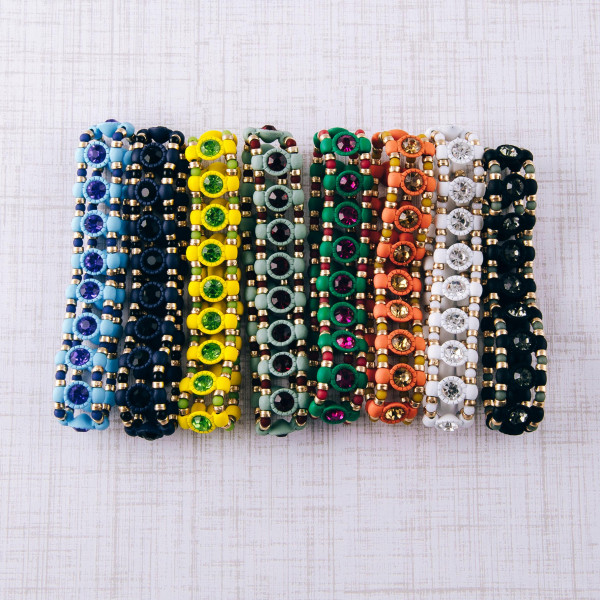"""Two tone rhinestone encased beaded stretch bracelet. Approximately 3"""" in diameter unstretched. Fits up to a 6"""" wrist."""