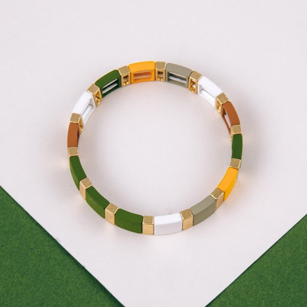 "Color block stretch bracelet with gold tones. Approximately 3"" in diameter unstretched. Fits up to a 6"" wrist."