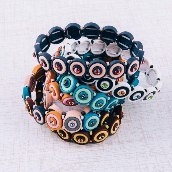 """Rhinestone encased bulls eye beaded stretch bracelet. Approximately 3"""" in diameter unstretched. Fits up to a 6"""" wrist."""