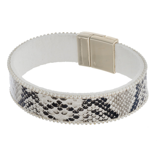 """Faux leather snakeskin magnetic bracelet. Approximately 3"""" in diameter. Fits up to a 6"""" wrist."""