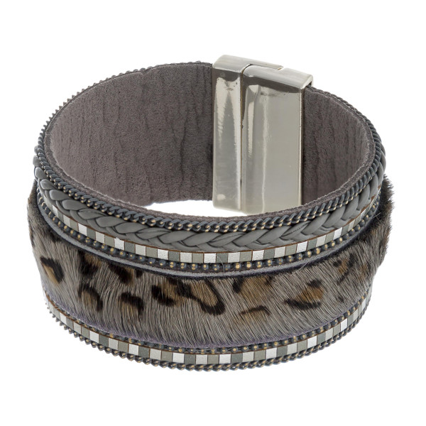 """Faux leather fur leopard print magnetic bracelet. Approximately 3.5"""" in diameter, 1"""" in width. Fits up to a 7"""" wrist."""