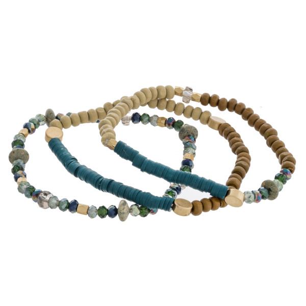 """Wood beaded stretch bracelet set featuring natural stone and spacer bead accents. Approximately 3"""" in diameter unstretched. Fits up to a 6"""" wrist."""