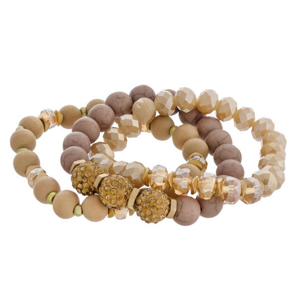 "Natural stone wood beaded rhinestone accented stretch bracelet set. Approximately 3"" in diameter unstretched. Fits up to a 6"" wrist."
