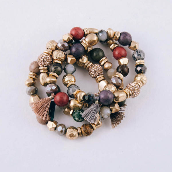 """Rhinestone natural stone beaded stretch bracelet with metal bead details and tassel accent. Approximately 3"""" in diameter unstretched. Fits up to a 6"""" wrist."""