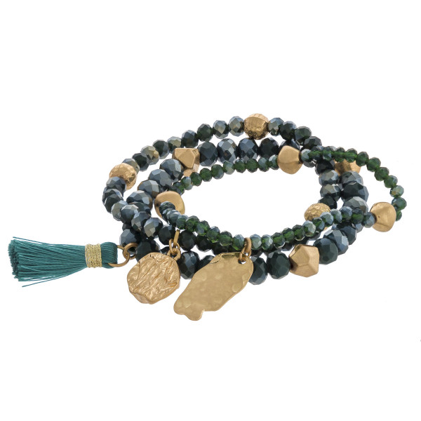 """Gold nugget charm beaded stretch bracelet set with tassel accent. Approximately 3"""" in diameter unstretched. Fits up to a 6"""" wrist."""