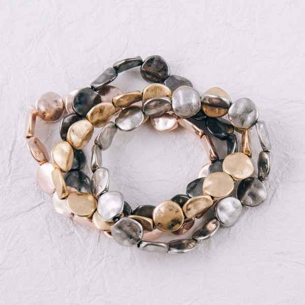 """Flat hammered disc beaded stretch bracelet. Approximately 3"""" in diameter unstretched. Fits up to a 6"""" wrist."""
