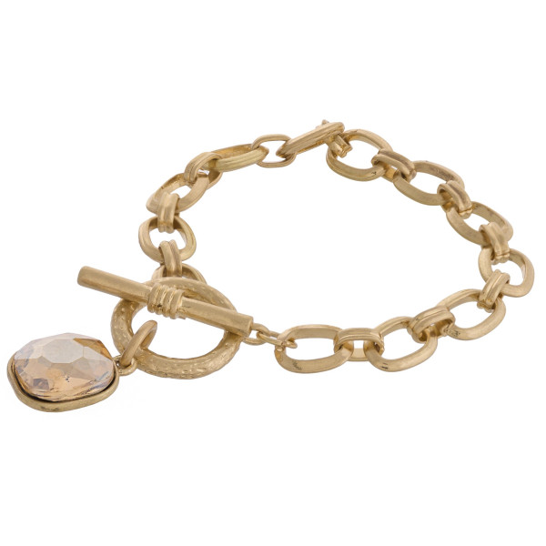 """Rhinestone encased chain link bracelet with toggle clasp. Approximately 3"""" in diameter. Fits up to a 6"""" wrist."""