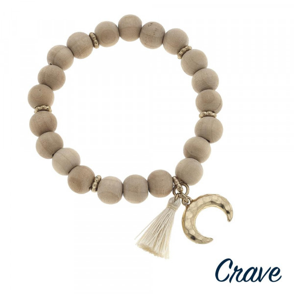 """Wood beaded stretch bracelet with crescent and tassel accents. Approximately 3"""" in diameter unstretched. Fits up to a 6"""" wrist."""