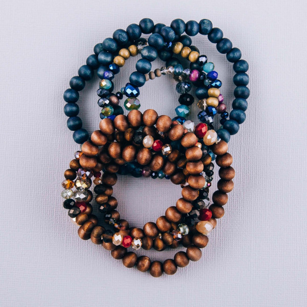 "Wood and faceted beaded stretch bracelet set. Approximately 3"" in diameter unstretched. Fits up to a 6"" wrist."