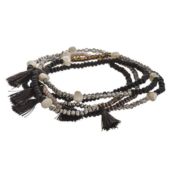 """Beaded stretch bracelet set featuring pearl and tassel accents. Approximately 3"""" in diameter unstretched. Fits up to a 6"""" wrist."""