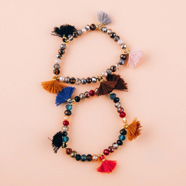 """Faceted beaded stretch bracelet with tassels. Approximately 3"""" in diameter unstretched. Fits up to a 6"""" wrist."""