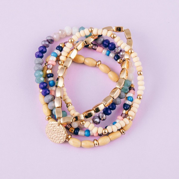 """Multicolor wood beaded stretch bracelet set featuring gold accents. Approximately 3"""" in diameter unstretched. Fits up to a 6"""" wrist."""