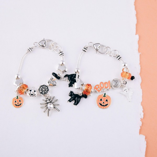 """Enamel coated Halloween character charm bracelet with heart lobster clasp closure. Approximately 3"""" in diameter. Fits up to a 6"""" wrist."""