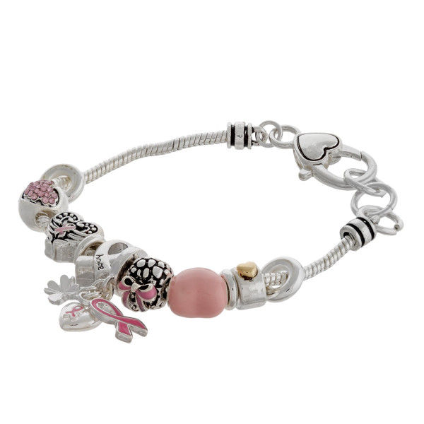"Breast Cancer Awareness charm bracelet with a lobster clasp closure. Approximately 3"" in diameter. Fits up to a 6"" wrist."