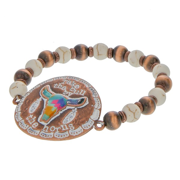"""Semi precious beaded stretch bracelet featuring copper tone focal with """"Take the bull by the horns"""" engraved details.  - Approximately 3"""" in diameter unstretched - Fits up to a 6"""" wrist"""