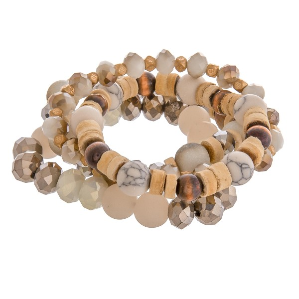 "Semi precious beaded stretch bracelet set of four with wood spacer bead details. Approximately 3"" in diameter unstetched. Fits up to a 6"" wrist."
