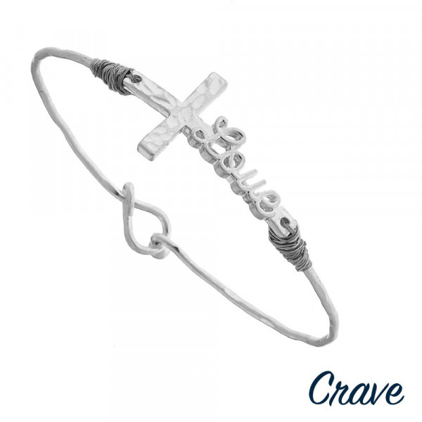 "Silver ""Love"" script east west cross bangle bracelet. Approximately 3"" in diameter. Fits up to a 6"" wrist."