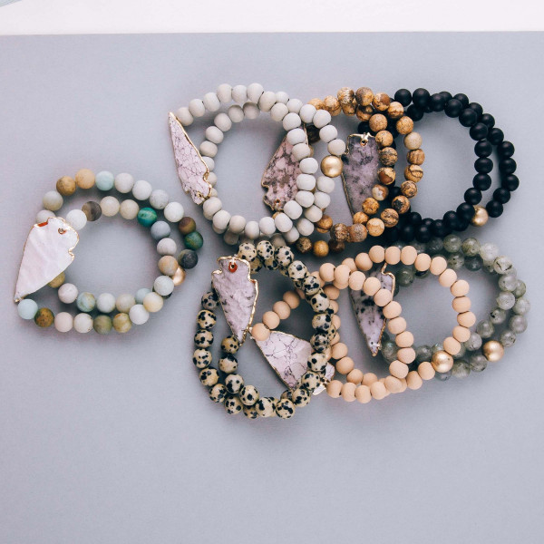 """Natural stone beaded bracelet set featuring a semi precious arrowhead focal. Approximately 3"""" in diameter unstretched. Fits up to a 6"""" wrist."""