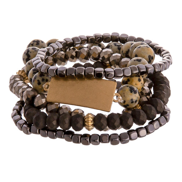 """Semi precious beaded stretch bracelet set featuring gold metal accents. Approximately 3"""" in diameter unstretched. Fits up to a 6"""" wrist."""