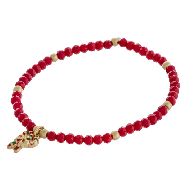 """Faceted beaded Christmas charm stretch bracelet. Approximately 3"""" in diameter unstretched. Fits up to a 6"""" wrist."""