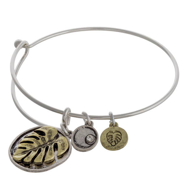 """Two tone leaf charm bangle bracelet with hook closure. Approximately 3"""" in diameter. Fits up to a 6"""" wrist."""