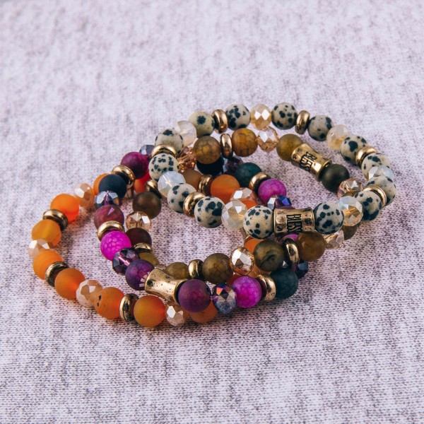 """Natural stone beaded stretch bracelet with """"Blessed"""" engraved bead detail. Approximately 3"""" in diameter unstretched. Fits up to a 6"""" wrist."""