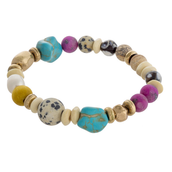 """Multi turquoise natural stone beaded stretch bracelet. Approximately 3"""" in diameter unstretched. Fits up to a 6"""" wrist."""