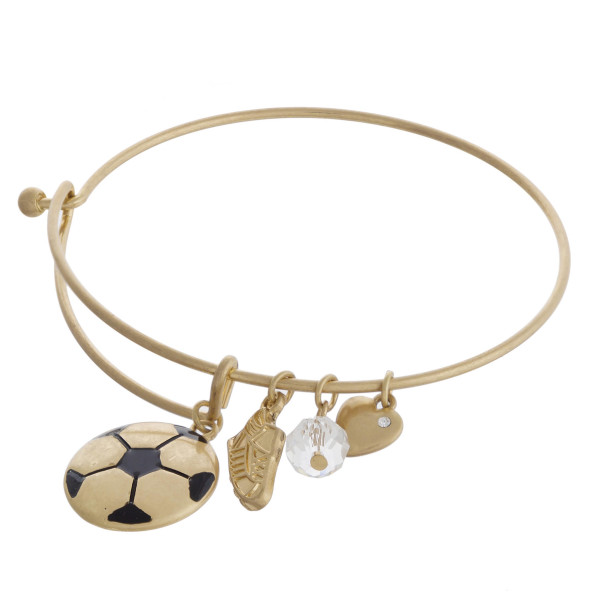 """Gold soccer charm bangle bracelet with hook closure. Approximately 3"""" in diameter. Fits up to a 6"""" wrist."""