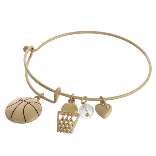 """Gold basketball charm bangle bracelet with hook closure. Approximately 3"""" in diameter. Fits up to a 6"""" wrist."""