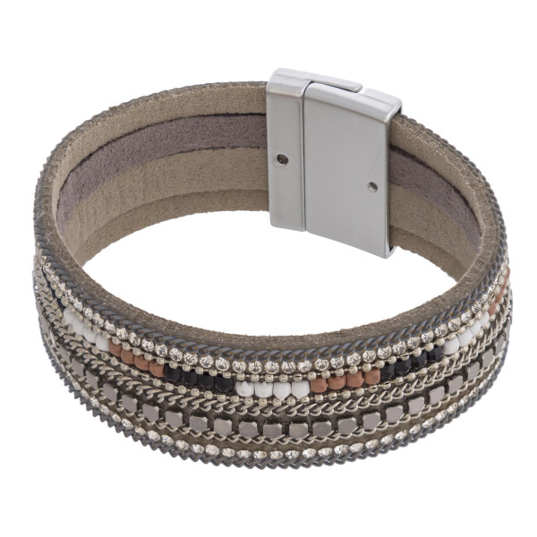 "Multi strand faux leather cubic zirconia beaded magnetic bracelet. Approximately 3"" in diameter. Fits up to a 6"" wrist."