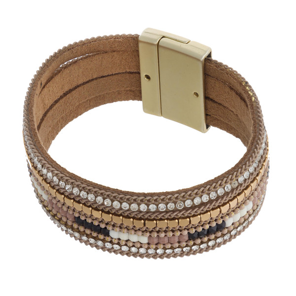 "Multi strand faux leather cubic zirconia beaded magnetic bracelet. Approximately 3"" in diameter, 1"" in width. Fits up to a 6"" wrist."