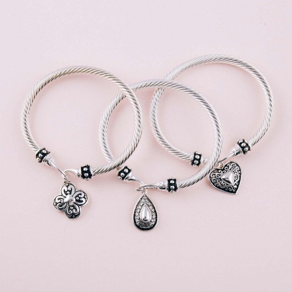 """Filigree heart charm bangle bracelet with hook closure. Approximately 3"""" in diameter. Fits up to a 6"""" wrist."""