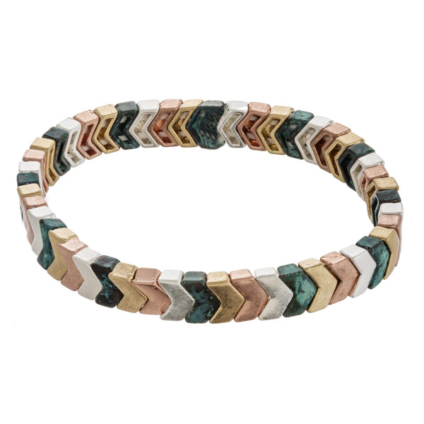 """Metal tone chevron beaded stretch bracelet. Approximately 3"""" in diameter unstretched. Fits up to a 6"""" wrist."""